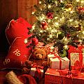 Brightly Lit Christmas Tree With Gifts by Sandra Cunningham