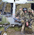 British Soldiers Help A Simulated by Andrew Chittock