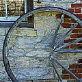 Broken Wagon Wheel Against The Wall by Randall Nyhof