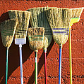 Brooms Leaning Against Wall by Garry Gay