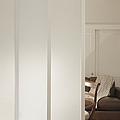 Brown Leather Sofa Seen Through Open Door by Andersen Ross