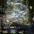 Bubble Blowr Of Central Park by Rob Hans