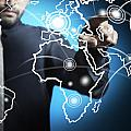 Businessman Touching World Map Screen by Setsiri Silapasuwanchai