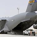C-17s Deliver, Pick-up Cargo by Stocktrek Images