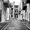 Calle De Guijarro by John Rizzuto