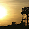 Camp Warhorse Guard Tower At Sunset by Terry Moore