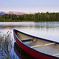 Canoe And Boya Lake At Sunset, Boya by Yves Marcoux