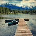 Canoes At Dock On Mountain Lake by Jill Battaglia