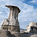 Capped Hoodoo And Clouds by David Kleinsasser