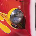 Car Headlight by Garry Gay