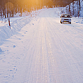 Car On Snow Covered Road by Jeremy Woodhouse