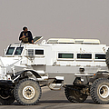 Casper Armored Vehicle Blocks The Road by Terry Moore