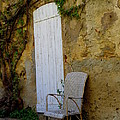 Chair By The White Door by Lainie Wrightson