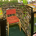 Chair In A Bookstore by Jaak Nilson