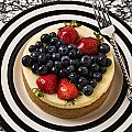 Cheese Cake On Black And White Plate by Garry Gay