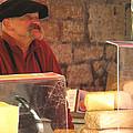 Cheese Seller At Sarlat Market by Greg Matchick