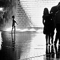 Child  Playing In Water Fountain by Michele Stoehr