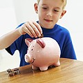 Child With A Piggy Bank by Ian Boddy