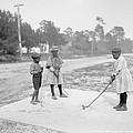 Children Playing Golf by Steve K