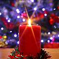 Christmas Candle With Starburst And Decorated Tree Background. by Richard Thomas