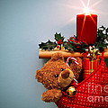 Christmas Stocking Filled With Presents With Candle And Holly. by Richard Thomas