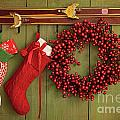Christmas Stockings And Wreath Hanging On  Wall by Sandra Cunningham