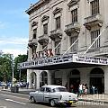 Classic Auto And Old Movie Theatre by John Malone