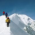 Climbers Hike Along A Ridge by Bill Hatcher