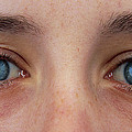Close-up Of A Woman's Blue Eyes by Damien Lovegrove