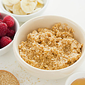 Close Up Of Oats And Fruits In Bowls, Studio Shot by Jamie Grill