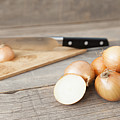 Close Up Of Onions And Knife On Table by Stefanie Grewel