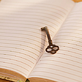 Close Up Of Open Notebook With Key, Studio Shot by Daniel Grill