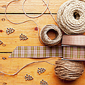 Close Up Of Ribbon, String And Shapes by Nils Hendrik Mueller