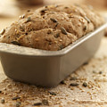 Close Up Of Rustic Bread In Loaf Pan by Adam Gault