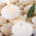 Close Up Of Tea Lights And Green Leaf On Pebble Stones, Studio Shot by Daniel Grill