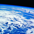 Clouds Over Earth Viewed From A Satellite by Stockbyte