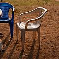 Coffee Cups Along With Chairs And Tables In A Quiet Location At Sunset by Ashish Agarwal