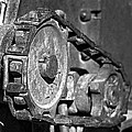Cog And Chain In Rust Black And White by Phyllis Denton