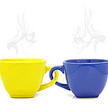 Color Cup With Hot Drink On White Background by Natthawut Punyosaeng