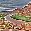 Colorado River Flows Through A Stormy Moab Portal by Gary Whitton