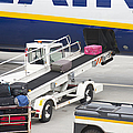 Conveyor Unloading Luggage by Jaak Nilson