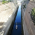 Corinth Canal Bridge Crossing And Sailboat In Greece by John Shiron