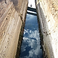 Corinth Canal Sail Boat And Sky Reflection In Water In Greece by John Shiron