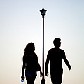 Couple Exercise While Walking At Sunset by Virginia Star