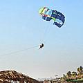 Couple Parasailing Over Shacks Goa by Kantilal Patel