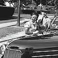 Couple Posing At Open Top Car, (b&w), Portrait by George Marks