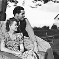 Couple Relaxing On Deckchair In Garden, (b&w) by George Marks