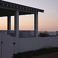 Covered Porch And Fence At Sunset by Roberto Westbrook