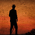 Cowboy At Sunset by Trish Tritz
