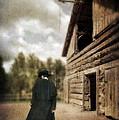 Cowboy Walking By Barn by Jill Battaglia